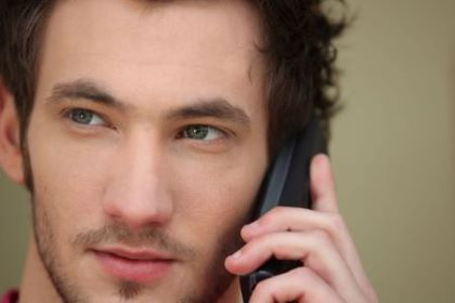 Young-man-on-phone-talking-about-mental-health-slide-420x280